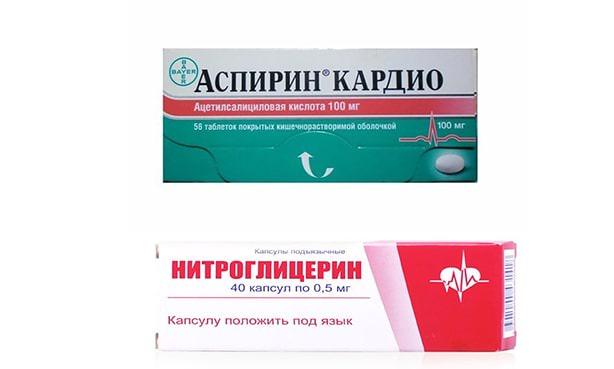 Таблетки аспирина и нитроглицерина
